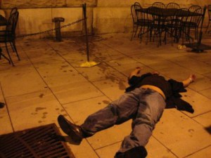 A frat boy, passed out in a pool of mysterious fluid that may or may not be vomit.