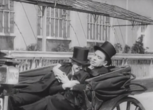 A Romantic Vintage Carriage Ride Featuring Two Men