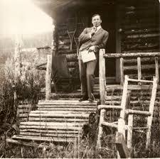 Robert W. Service In A Log Cabin