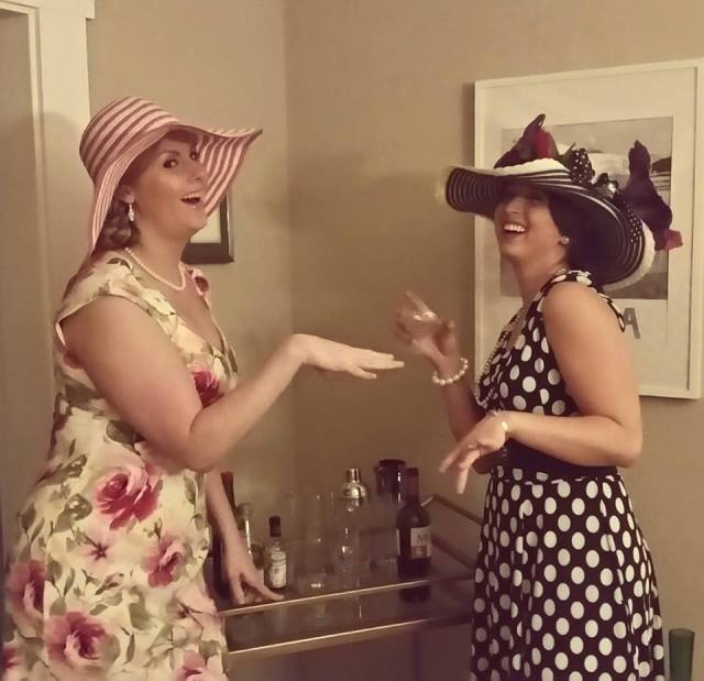 Classy Ladies Share A Laugh Over The Bar Cart