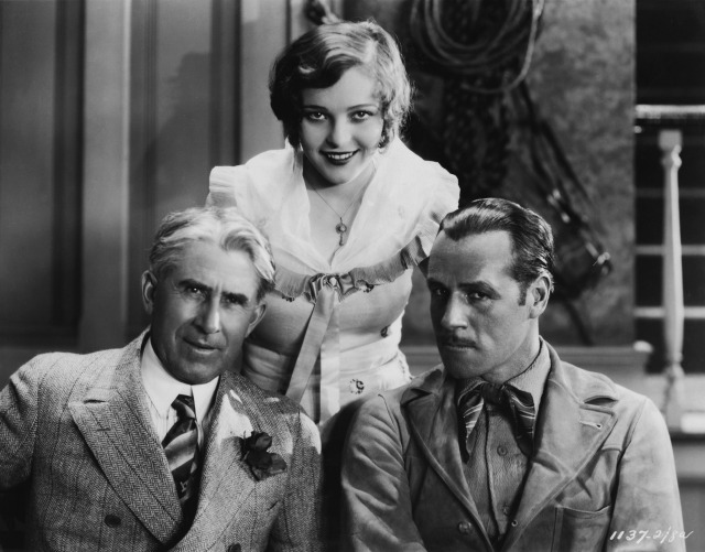 1928 --- Winning Combination: Zane Grey, author of which Paramount is now filming, with Jack Holt, the featured lead, and Sally Blane, leading lady. The picture was taken on set at the studio when Grey visited there. 1928, directed by John Waters. --- Image by © Bettmann/CORBIS
